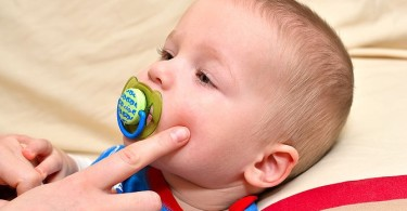 Allergy in infants and pimples on face child