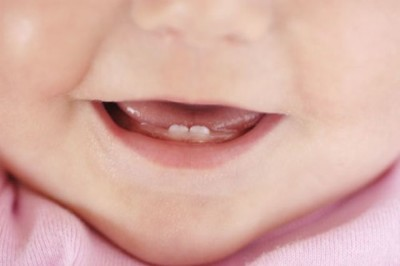 How can I help my child during teething